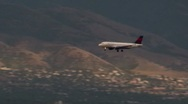 Stock Video Footage of Airplane Jet coming in for a landing in the salt lake mountain airport