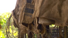 CU burlap bags hanging on fence - stock footage