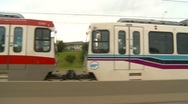 Drive plate, Light rail train and road, #1, no traffic, match speed Stock Footage