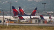 Stock Video Footage of Airplanes parked at the airport