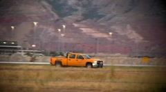 Bright Yellow Truck Driving on the Airport Runway Stock Footage