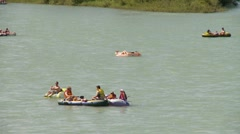 Dinghies and inflatable boats on river, #5 medium shot Stock Footage