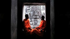 Two Monks chatting inside the Bayon temple, Angkor, Siem Reap, Cambodia Stock Footage