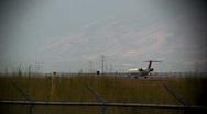 Stock Video Footage of Jet turns around on the landing pad