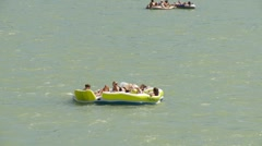 Dinghies and inflatable boats on river, #11 zoom back Stock Footage