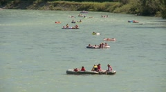Dinghies and inflatable boats, #2 on river long shot Stock Footage