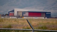 Stock Video Footage of Salt Lake Airport Hanger American Flag Barbed Wire Fence