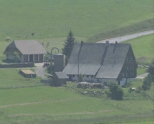 Zoom out from farmhouse buildings in middle of fields Stock Footage