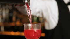 Barkeeper pouring a fresh mixed cocktail Stock Footage