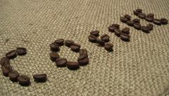 Coffee beans on traditional sack textile, kind of a background Stock Footage