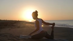 Woman yoga meditation peace beach sunrise exercise spiritual Stock Footage