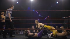 Pro wrestling match- Tag team moves - Dropkick HD Stock Footage