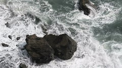 Waves Break Over Boulders Stock Footage