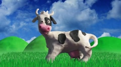 Clay animation cow eating grass Stock Footage