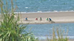 Children Playing on the Beach tilt up 1 Stock Footage