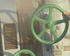 Close up of chain winching out on ship machinery Stock Footage