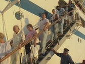 Stock Video Footage of People leaving cruise ship and going down stairs