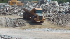 Heavy Construction Mining Trucks Carrying Stone Aggregate Stock Footage