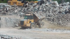 Heavy Trucks Carrying Rocks From A Hillside Construction Site Stock Footage