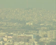 Zoom out from distant city to ruins with narration Stock Footage