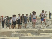 Stock Video Footage of Tourists walking and standing on ruins