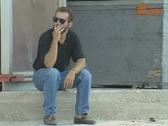 Stock Video Footage of Man sitting and smoking