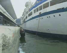 Close up of harbourside as cruise ship pulls away - stock footage
