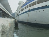 Stock Video Footage of Close up of harbourside as cruise ship pulls away