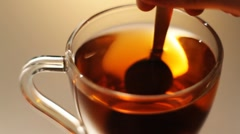 Stir tea with a spoon - stock footage