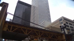 Looking up as two trains pass on the elevated railway, Chicago Stock Footage