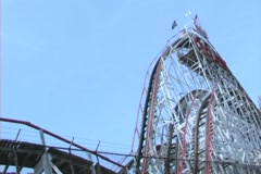 Cyclone with Roller Coaster going up and down - stock footage