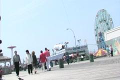 Coney Island Boardwalk with Wonder Wheel in background Stock Footage