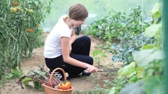 Young teenage girl working in garden HD Stock Footage