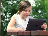 Young teenage girl with tablet computer outdoors, dolly shot NTSC Stock Footage