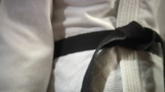 Stock Video Footage of Tightening Black Belt - Martial Arts Uniform Alternate