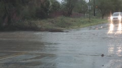 """Flash flood close with sign showing """"Flood Area"""" - series - 4 Stock Footage"""