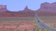 Stock Video Footage of Vehicles drive past monument valley in Utah