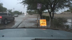 """Flash flood close with sign showing """"Flood Area"""" - series - 6 Stock Footage"""