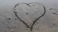 Heart in Sand Deletion Stock Footage