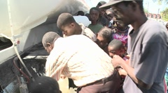 Earthquake refugees line up for supplies in Haiti. Stock Footage