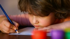 Little girl enthusiastically paints pencils Stock Footage