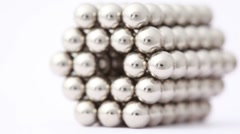 Hand take magnet balls in hexagonal tunnel structure Stock Footage