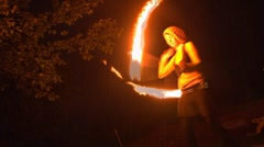 Female Firedancer in the Rain Stock Footage