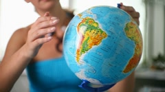Girl studying a globe Stock Footage