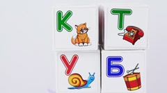 Some cubes with letters and images on it Stock Footage