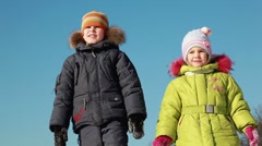 Two kids stand, look and tell something Stock Footage