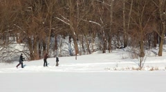 Father, mother and son skiing at winter day Stock Footage