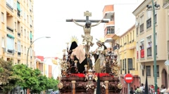 Stock Video Footage of Statue of Jesus Christ being carried by Costaleros, Malaga, Spain