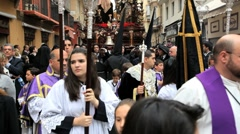 Stock Video Footage of Parade of young people with Costaleros bearing a Trono, Malaga, Spain