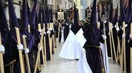 Stock Video Footage of Hooded Nazarenos parade during the celebration of Semana Santa, Malaga Spain